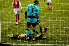 Soccer players in net Stock Image