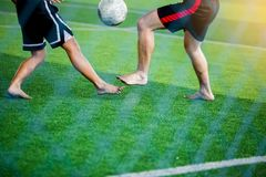 Soccer players not wearing a sport shirt and barefoot do trap and control the ball for shoot to goal stock photography