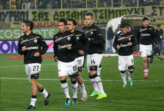 The soccer players Paok gets into the playing area Stock Photography