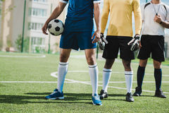 Soccer players and referee standing on soccer pitch before game Stock Photos
