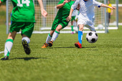 Soccer players running with ball. Football soccer match for children. Training and football soccer tournament. Boys playing football game Royalty Free Stock Photography