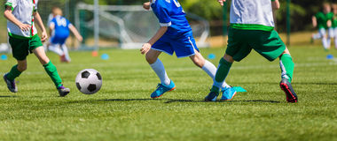 Soccer players running with ball Royalty Free Stock Image