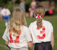 Soccer Players on Sidelines. Girl soccer players on sidelines during game with pony tails Stock Images
