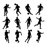 Soccer players silhouettes Stock Photos