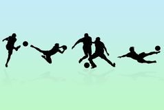 Soccer Players Silhouettes. Over green and blue background Royalty Free Stock Photos