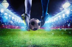 Soccer players with soccerball at the stadium during the match Stock Photos