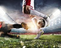 Soccer players with soccerball at the stadium during the match. Soccer players with soccerball at the illuminated stadium during the match royalty free stock photography