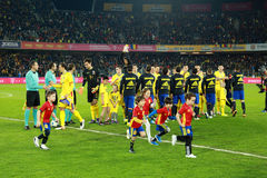 Soccer players of Spain and Romania enter the field Royalty Free Stock Images