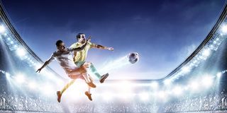 Soccer players on stadium in action. Mixed media royalty free stock photos