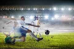 Soccer players on stadium in action. Mixed media royalty free stock images