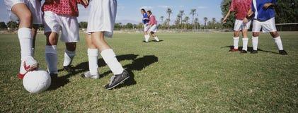 Soccer Players Tackling Football royalty free stock photos