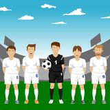 Soccer players team group standing with ball in stadium. Soccer players team group standing with ball in the stadium Royalty Free Stock Photo