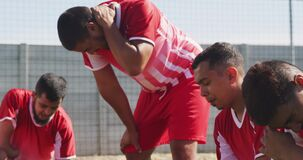 Soccer players tired after training on the field