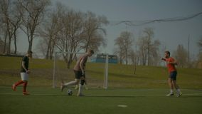 Soccer players training football on the pitch stock video