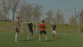 Soccer players training football in the pitch stock video footage