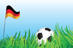 Soccer playground, germany. An illustrations of soccer ball, with a germany flag waving at the background Stock Images