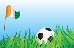 Soccer playground, ivory coast. An illustrations of soccer ball, with ivory coast flag waving at the background Royalty Free Stock Photos