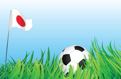 Soccer playground, japan. An illustrations of soccer ball, with a japan flag waving at the background Royalty Free Stock Images