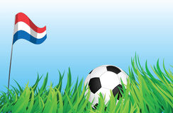 Soccer playground, netherlands. An illustrations of soccer ball, with a netherlands flag waving at the background Royalty Free Stock Photos
