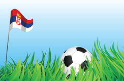 Soccer playground, serbia. An illustrations of soccer ball, with a serbia flag waving at the background Stock Photos