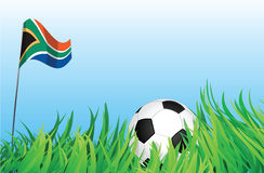 Soccer playground, south africa. An illustrations of soccer ball, with a south africa flag waving at the background Stock Photo
