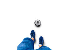 Soccer Pllayer legs with soccer ball on white. Point of view of a player man legs with soccer ball on white. Concept football play background royalty free stock image