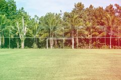Soccer posts in park, field is partially covered in the shadow. Trees in the background are in the sun. Rio de Janeiro, Brazil. Co. Soccer posts in park, field Stock Photos