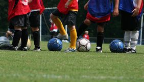Soccer practice. Boys lining up for soccer practice stock image