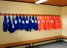 Soccer practice vests. Hanging on a rack in a locker room Stock Photography