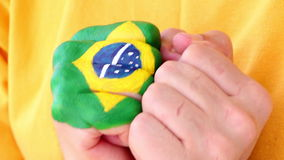 Soccer-Reaction of a brazilian football soccer fan before a goal, brazilian flag on his fist stock video footage