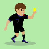 Soccer referee giving yellow card Stock Image