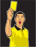 Soccer referee giving yellow card Stock Images