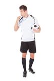 Soccer referee holding football Royalty Free Stock Photo