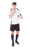 Soccer Referee Holding Football Stock Images