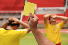 Soccer Referee shoe yellow card Stock Photography