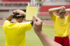 Soccer referee show yellow card Royalty Free Stock Photos