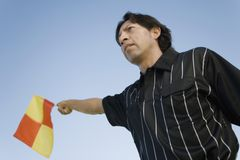 Soccer Referee Showing Offside Flag Stock Images