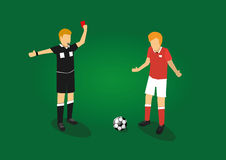 Soccer referee showing red card to a soccer player Royalty Free Stock Images