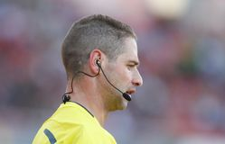 Soccer referee speaking with assistants during match. Soccer referee speaks to his assitant during his match in the island of mallorca. Technology in sports are royalty free stock photo