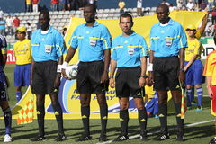 Soccer referees. Row of soccer referees before match Stock Image