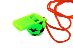 Soccer related whistle, green. Green Soccer Ball whistle with red string royalty free stock image