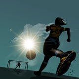 Soccer running with ball Royalty Free Stock Photos