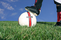 Soccer scene. Close-up of soccer ball and feet stock image