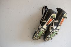 Soccer shoes. On the wall Royalty Free Stock Photos
