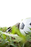Soccer shoes & football. On the green grass stock image