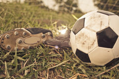 Soccer shoes & football Royalty Free Stock Photography