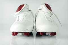 Soccer shoes isolated. White leather soccer shoes with reflection Stock Photo