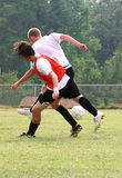 Soccer Shove. Fierce competition between two soccer players stock photo