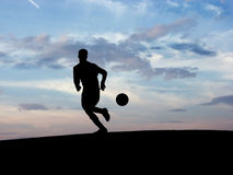 Soccer Silhouette. Soccer player controlling a ball Stock Photography