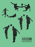 Soccer silhouettes in green vector Stock Images